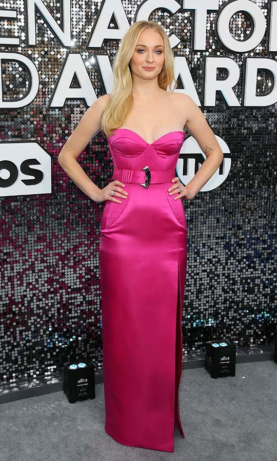 All eyes were on <a href=/tags/0/sophie-turner><strong>Sophie Turner</a></strong> thanks to her hot pink strapless gown with belt. <p>Photo: &copy; JEAN-BAPTISTE LACROIX/AFP via Getty Images