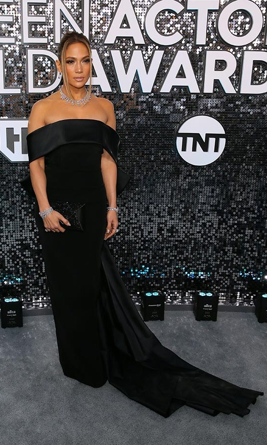 <a href=/tags/0/jennifer-lopez><strong>Jennifer Lopez</strong></a> slayed in a black dress with megawatt jewels. <p>Photo: &copy; JEAN-BAPTISTE LACROIX/AFP via Getty Images