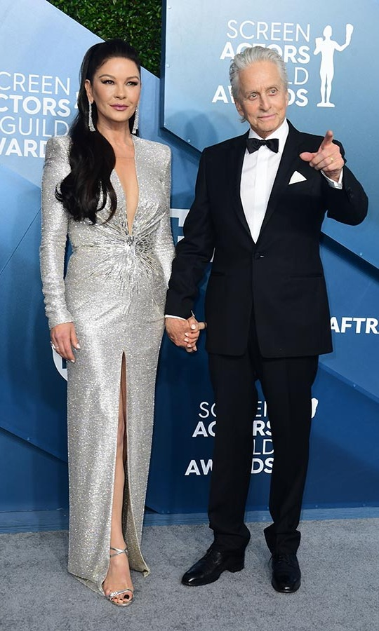 What a sophisticated pair! <a href=/tags/0/catherine-zeta-jones><strong>Catherine Zeta-Jones</a></strong> and husband <a href=/tags/0/michael-douglas><strong>Michael Douglas</strong></a> kicked the elegance up a notch when they stepped onto the silver carpet. <p>Photo: &copy; FREDERIC J. BROWN/AFP via Getty Images