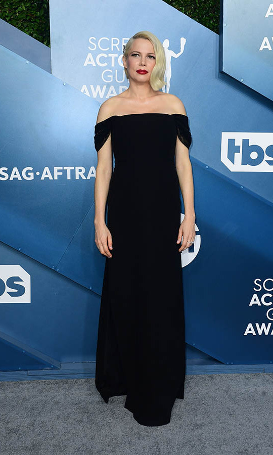 <strong><a href=/tags/0/michelle-williams>Michelle Williams</a></strong> looked gorgeous in a black off-shoulder gown.
