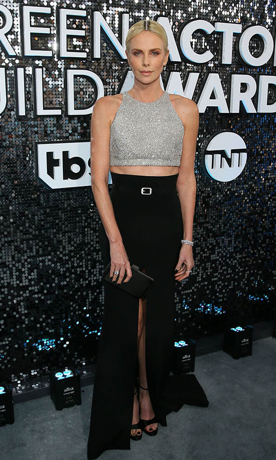 <a href=/tags/0/charlize-theron><strong>Charlize Theron</strong></a> was thoroughly modern in a twinkling crop top and black maxi skirt with an embellished partline. <p>Photo: &copy; JEAN-BAPTISTE LACROIX/AFP via Getty Images