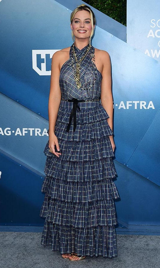 Instead of embellishment,  <a href=/tags/0/margot-robbie><strong>Margot Robbie</strong></a> added interest to her look with a frilled plaid dress and plenty of gold jewelry. <p>Photo: &copy; FREDERIC J. BROWN/AFP via Getty Images