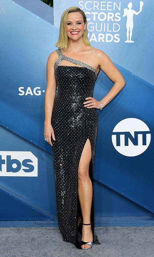 <a href=/tags/0/reese-witherspoon><strong>Reese Witherspoon</a></strong> lit up the silver carpet with her studded gown with shimmering strap. And we cannot forget about her smile! <p>Photo: &copy; FREDERIC J. BROWN/AFP via Getty Images