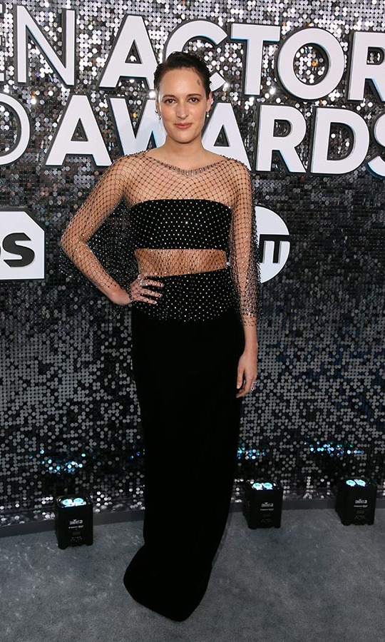 <a href=/tags/0/phoebe-waller-bridge><strong>Phoebe Waller-Bridge</strong></a> took her black separates to the next level with an embellished netted overlay. <p>Photo: &copy; JEAN-BAPTISTE LACROIX/AFP via Getty Images