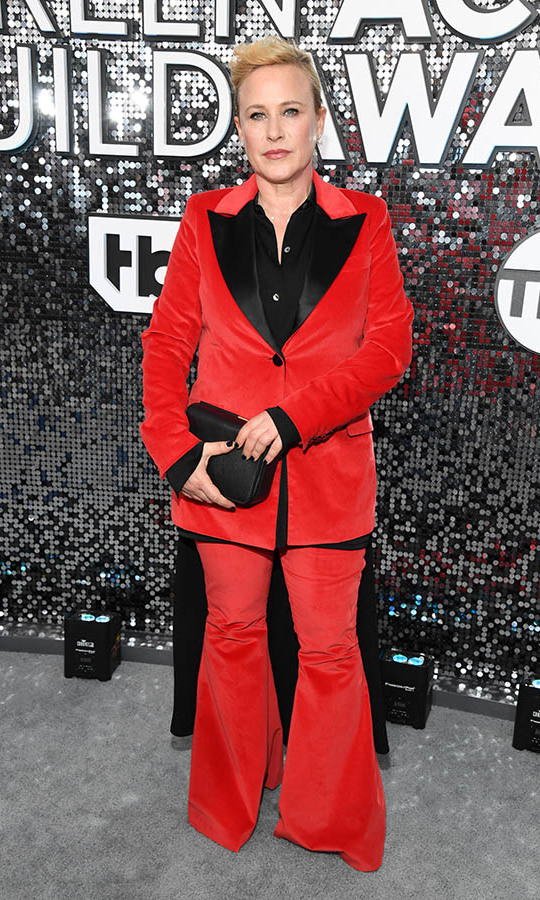 <a href=/tags/0/patricia-arquette><strong>Patricia Arquette</strong></a> turned heads in a red and black suit with coordinating accessories. <p>Photo: &copy; Kevin Mazur/Getty Images for Turner