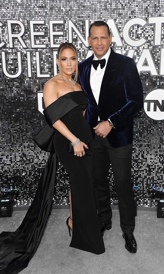 <a href=/tags/0/alex-rodriguez><strong>Alex Rodriguez</strong></a> showed his support for fiancé <a href=/tags/0/jennifer-lopez><strong>Jennifer Lopez</strong></a>, who was nominated for the Screen Actors Guild Award for Outstanding Performance by a Female Actor in a Supporting Role for <em>Hustlers</em>. The two also coordinated in luxurious black ensembles! <p>Photo: &copy; Frazer Harrison/Getty Images
