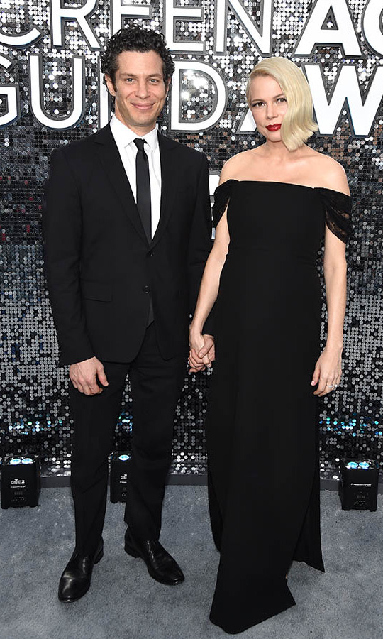 <a href=/tags/0/michelle-williams><strong>Michelle Williams</strong></a> and fiancé <strong>Thomas Kail</strong> sweetly held hands. It was recently revealed that they are expecting their first child together. <p> Photo: &copy; John Shearer/Getty Images for PEOPLE