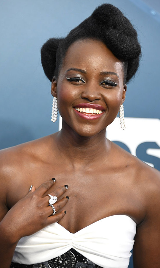 <a href=/tags/0/lupita-nyongo><strong>Lupita Nyong'o</strong></a>'s rings and chandelier earrings shone as bright as her smile! The actress wore 90 carats worth of <strong>Forevermark</strong> diamonds. <p>Photo: &copy; Steve Granitz/WireImage