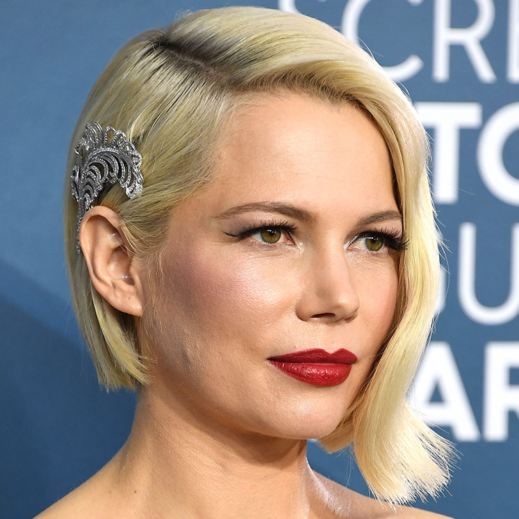 <a href=/tags/0/michelle-williams><strong>Michelle Williams</strong></a> ensured she made a memorable impression with her <strong>Forevermark</strong> 6.37-carat diamond feather brooch clipped just above her ear. Her retro-inspired blonde bob suited the hair accessory perfectly. <p>Photo: &copy; Steve Granitz/WireImage