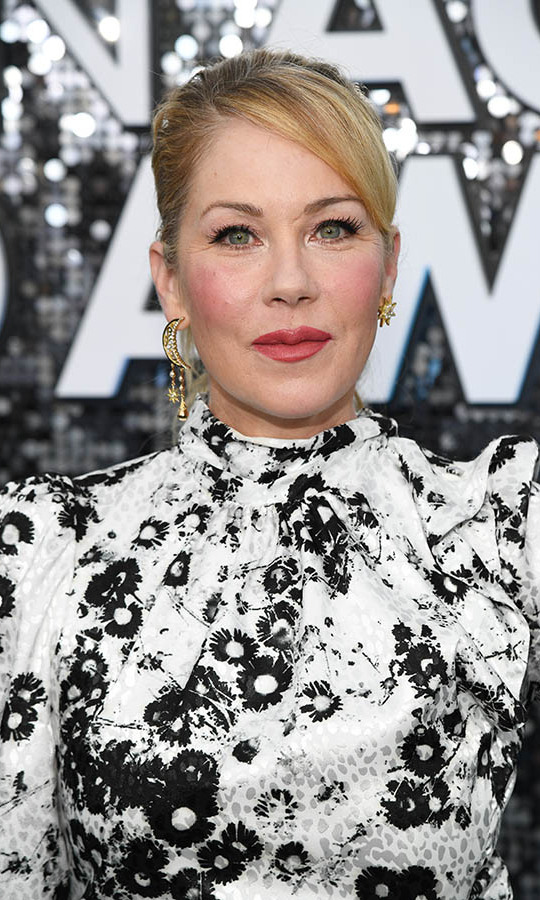 Who says that earrings need to match? <a href=/tags/0/christina-applegate><strong>Christina Applegate</strong></a> accessorized with a celestial pair of earrings featuring a dangling moon on one ear and a delicate star on the other. It offered a trendy finish! <p>Photo: &copy; Kevin Mazur/Getty Images for Turner