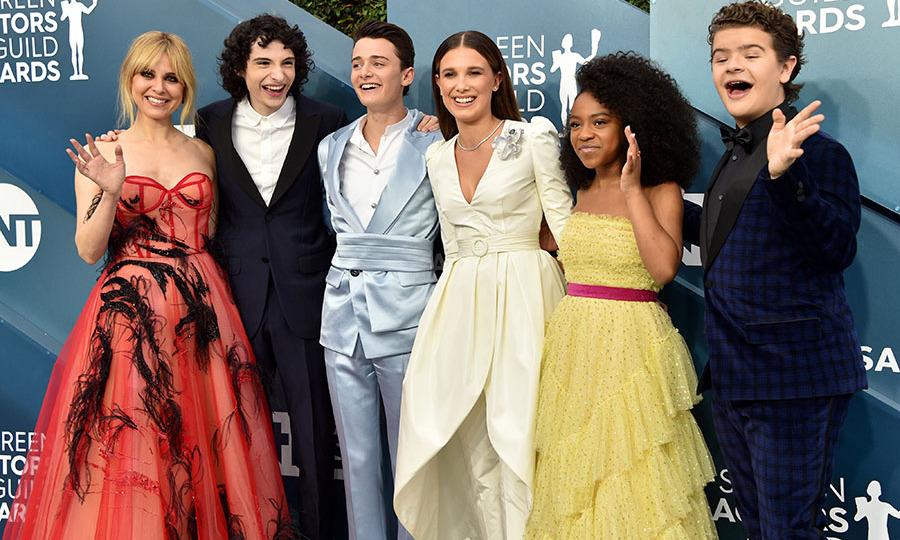 They're growing up! The cast of <em>Stranger Things</em> had a joyful reunion at the 2020 SAG Awards. The group, which included <strong>Cara Buono</strong>, <a href=/tags/0/finn-wolfhard><strong>Finn Wolfhard</strong></a>, <a href=/tags/0/noah-schnapp><strong>Noah Schnapp</strong></a>, <a href=/tags/0/millie-bobby-brown><strong>Millie Bobby Brown</strong></a>, <strong>Priah Ferguson</strong> and <strong>Gaten Matarazzo</strong>, grinned and waved to the cameras. <p> Photo: &copy; Gregg DeGuire/Getty Images for Turner