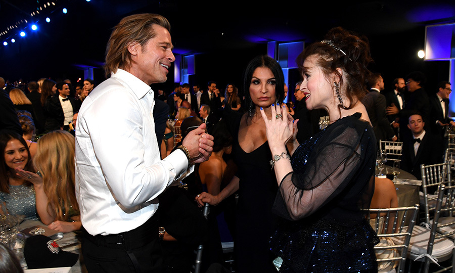 <strong><a href=/tags/0/brad-pitt>Brad Pitt</a></strong> and <strong><a href=/tags/0/helena-bonham-carter>Helena Bonham Carter</strong></a> were spotted catching up during the show. Do you think they were talking about <i>Fight Club</i>? Probably not, right, since that would involve violating the first rule. ... Oh. Whoops. Sorry.