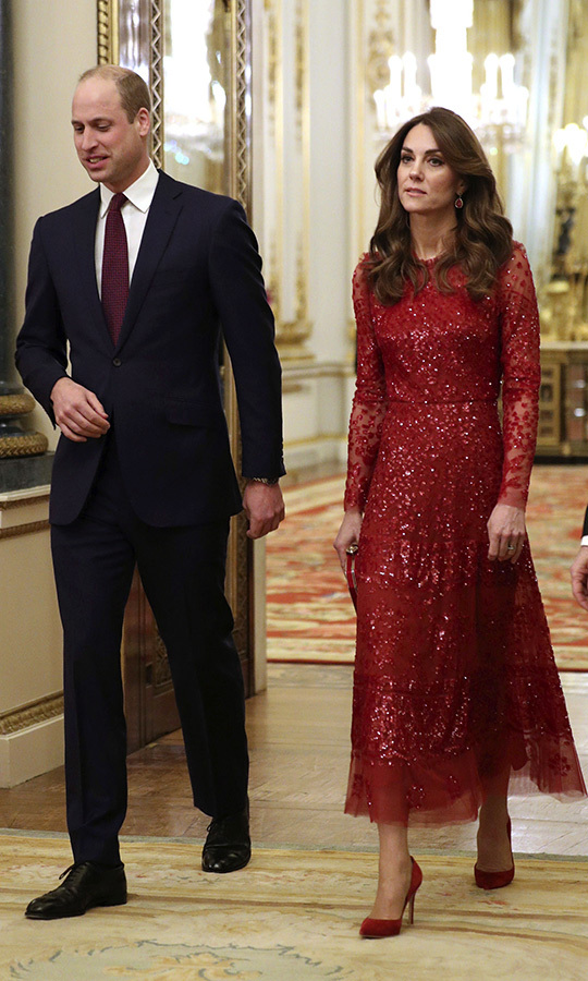 Kate looked breathtaking in a stunning ruby red gown by <strong>Needle and Thread</strong>, which she paired with <strong><a href=/tags/0/gianvito-rossi>Gianvito Rossi</a></strong> red suede pumps and a matching clutch.