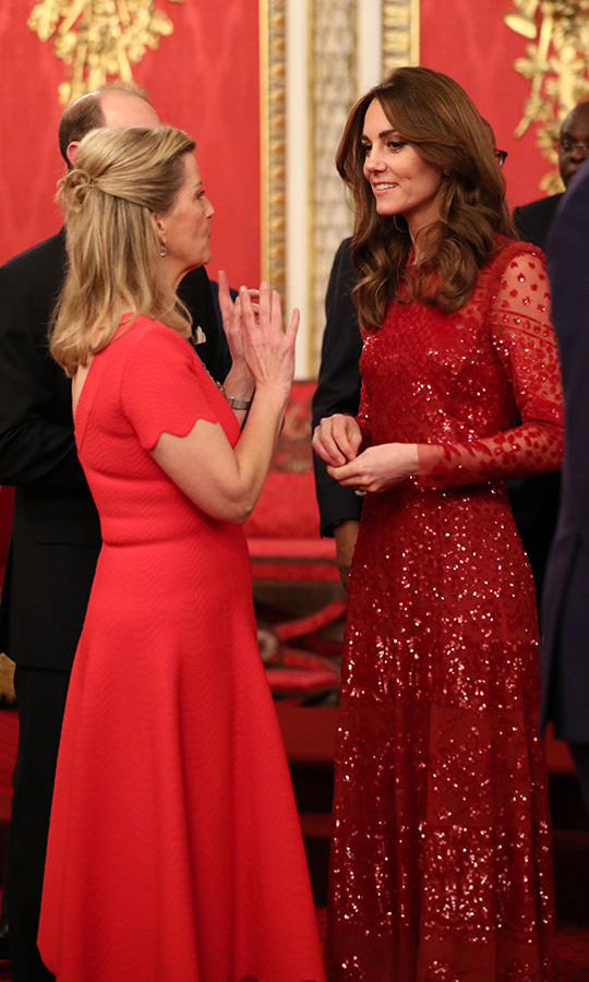 Kate was spotted chatting with the <strong><a href=/tags/0/countess-of-wessex>Countess of Wessex</a></strong>, who looked similarly stunning in red. It was Sophie's 55th birthday, and she looked excited and thrilled to be joining the event.