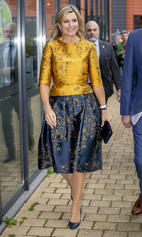 What a statement ensemble! <a href=/tags/0/queen-maxima><strong>Queen Maxima</strong></a> wore gold and navy separates with opposite patterns to visit the Scouting Netherlands cubs on Jan. 15 in Noordwijkerhout, Netherlands.<p>Photo: &copy; Patrick van Katwijk/Getty Images