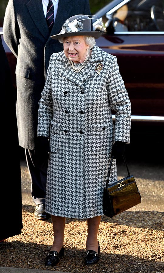 <a href=/tags/0/queen-elizabeth-ii><strong>Queen Elizabeth II</strong></a> looked elegant in a white and gray houndstooth coat with brimmed hat as she attended church at St Mary the Virgin church in Sandringham on Jan. 19. <p>Photo: &copy; Karwai Tang/WireImage