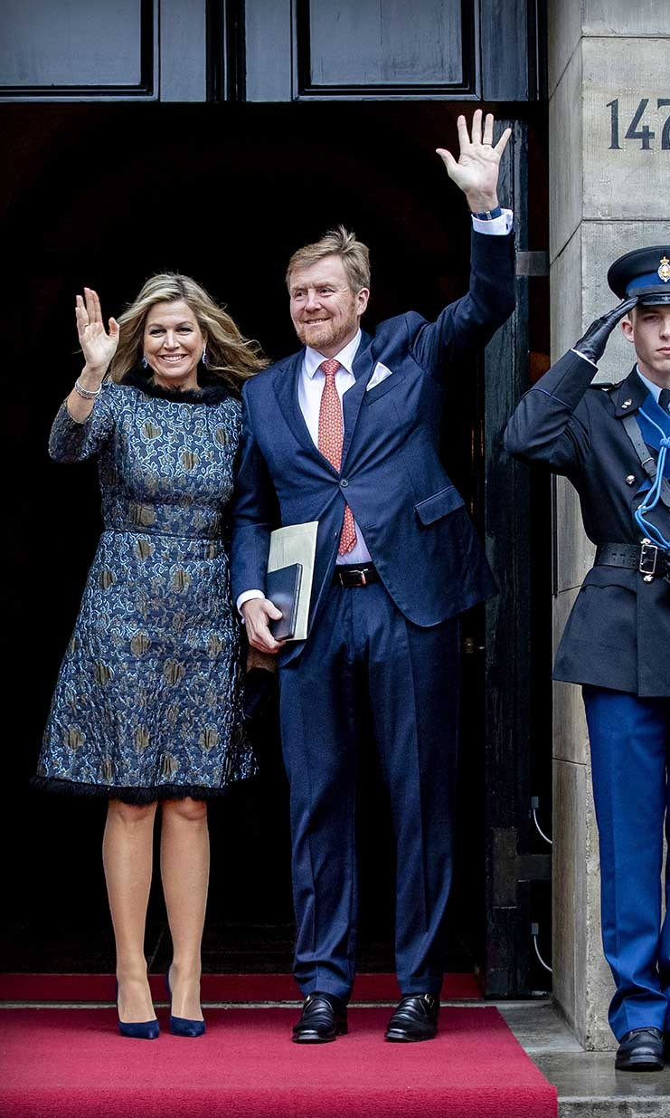 <a href=/tags/0/queen-maxima><strong>Queen Maxima</strong></a> and <a href=/tags/0/king-willem-alexander><strong>King Willem-Alexander</strong></a> coordinated in blue when they attended the New Year Reception in the Royal Palace on Jan. 14 in Amsterdam. Her rich blue brocade dress had accents of deep gold. <p>Photo: &copy; Patrick van Katwijk/Getty Images