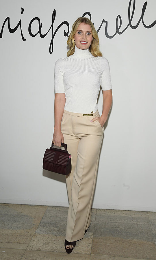 <a href=/tags/0/lady-kitty-spencer><strong>Lady Kitty Spencer</strong></a> was also at the Paris Fashion Week event. She looked chic in light neutral tones and dark accessories. <p> Photo: &copy; Pascal Le Segretain/Getty Images