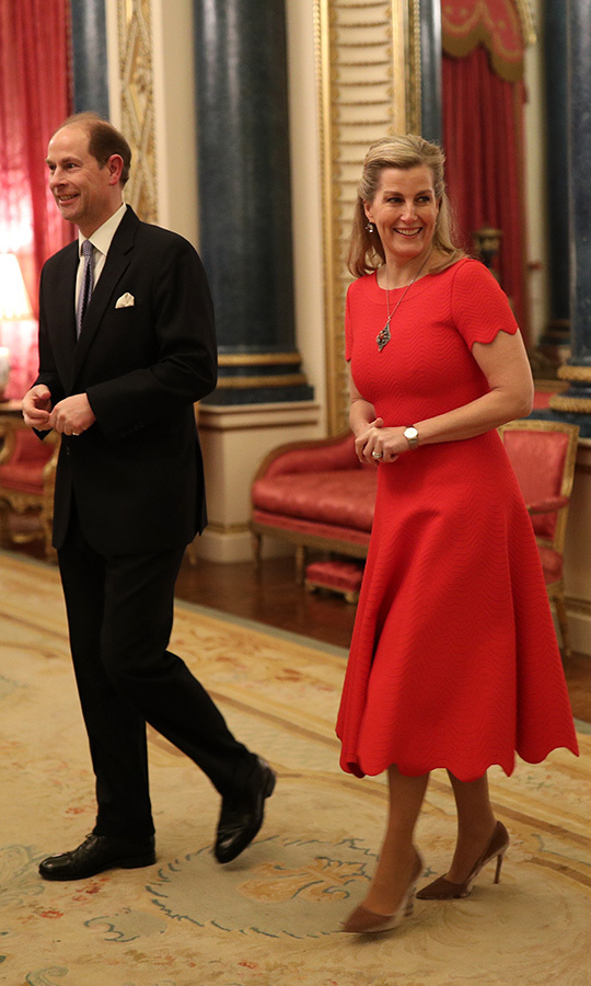 <a href=/tags/0/countess-of-wessex><strong>Sophie, Countess of Wessex</a></strong> looked supremely chic in a red dress with scalloped hemlines at the UK-Africa Summit at Buckingham Palace on Jan. 20. She was joined by <a href=/tags/0/prince-edward><strong>Prince Edward</strong></a>.<p>Photo: © Yui Mok - WPA Pool/Getty Images