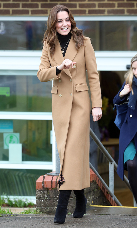 Kate arrived at the Ely and Careau Children's Centre in a camel <strong><a href=/tags/0/massimo-dutti>Massimo Dutti</a></strong> coat, which she paired with black high heel boots. Underneath, she sported a $17 leopard-print skirt from <strong><a href=/tags/0/zara>Zara</a></strong>. 