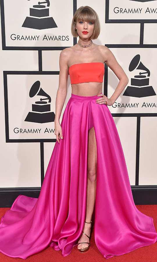 <h2>Taylor Swift, 2016</h2><p><a href=/tags/0/taylor-swift><strong>Taylor Swift</strong></a> surprised with her vivid <a href=/tags/0/versace><strong>Atelier Versace</strong></a> ensemble at the 58th GRAMMYs. A fiery orange bandeau top was juxtaposed with a hot pink skirt with open front. <p>Photo: &copy; Axelle/Bauer-Griffin/FilmMagic