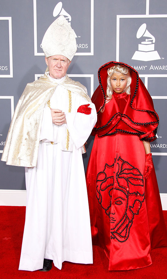 <h2>Nicki Minaj, 2012</h2><p><a href=/tags/0/nicki-minaj><strong>Nicki Minaj</strong></a> brought a special guest to the 54th GRAMMYs. Her outfit was equally dramatic. The rapper wore a red <a href=/tags/0/versace><strong>Versace</strong></a> cape dress emblazoned with a Medusa head. <p>Photo: &copy; Dan MacMedan/WireImage