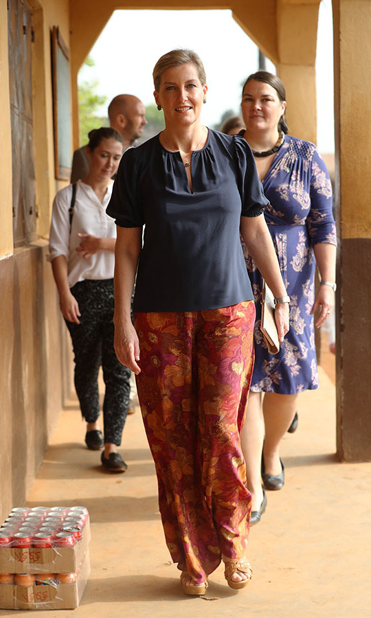 <a href=/tags/0/countess-of-wessex><strong>Sophie, Countess of Wessex</strong></a> added some vibrancy to her navy top with multicoloured wide-leg trousers and mustard sandals during a visit to the Russell Technical Secondary School in Sierra Leone on Jan. 23.<p>Photo: &copy; Jonathan Brady/PA Images via Getty Images