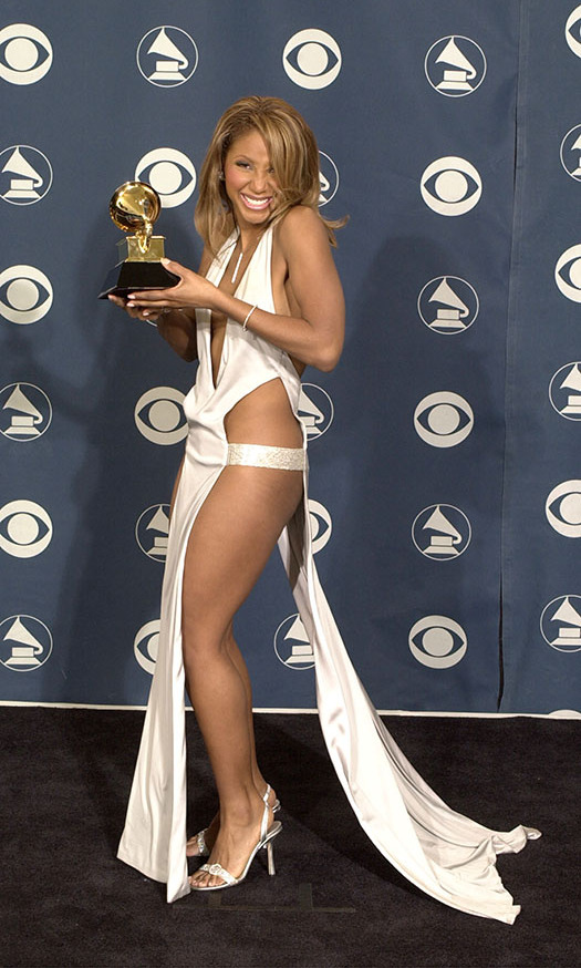 <h2>Toni Braxton, 2001</h2><p><strong>Toni Braxton</strong> left little to the imagination with her racy gown at the 2001 GRAMMYs. Here she is posing backstage with her award for Best Female R&B Vocal Performance. <p>Photo: &copy; David McNew/Newsmakers