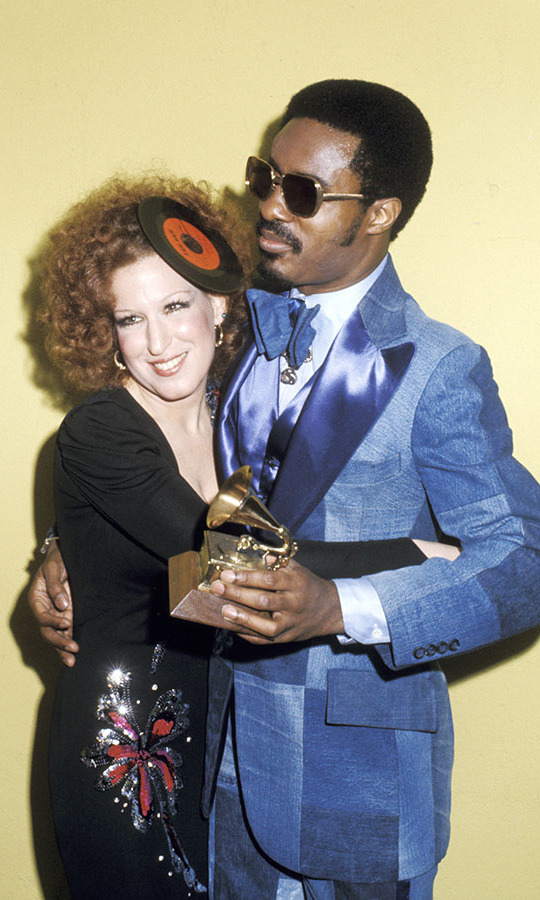 <h2>Bette Midler and Stevie Wonder, 1975</h2><p>Back in 1975, <a href=/tags/0/bette-midler><strong>Bette Midler</strong></a> dressed for the theme with a record (remember those?) fascinator! <strong>Stevie Wonder</strong> also made a style statement in a denim patchwork suit. <p>Photo: &copy; Ron Galella/Ron Galella Collection via Getty Images