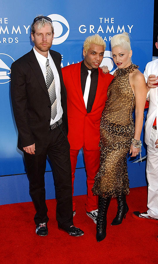 <h2>No Doubt, 2002</h2><p><a href=/tags/0/no-doubt><strong>No Doubt</strong></a> showcased their rocking aesthetic with their outfits at the 2002 GRAMMYs. <a href=/tags/0/gwen-stefani><strong>Gwen Stefani</strong></a> struck a fierce pose in a sheer leopard dress with tall boots. <p>Photo: &copy; Gregg DeGuire/WireImage
