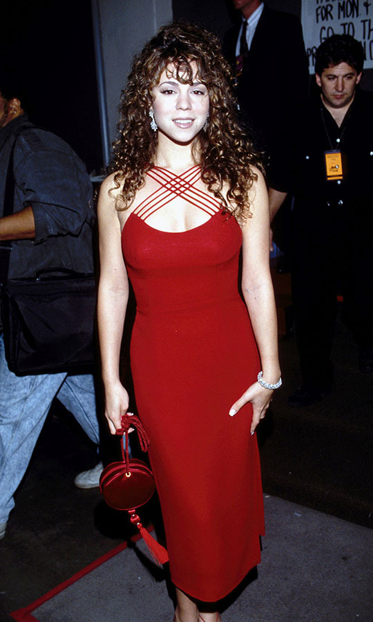 <h2>Mariah Carey, 1993</h2><p>At the 35th GRAMMYs, <a href=/tags/0/mariah-carey><strong>Mariah Carey</strong></a> looked sensational in a red gown with crisscross straps. <p>Photo: &copy; Kevin Mazur/WireImage