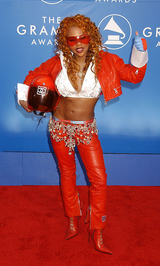 <h2>Lil' Kim, 2002</h2><p>Ready to race! <strong>Lil' Kim</strong> went with a high speed look, complete with  a <a href=/tags/0/chanel><strong>Chanel</strong></a> helmet, to the 44th GRAMMYs. <p>Photo: &copy; Gregg DeGuire/WireImage