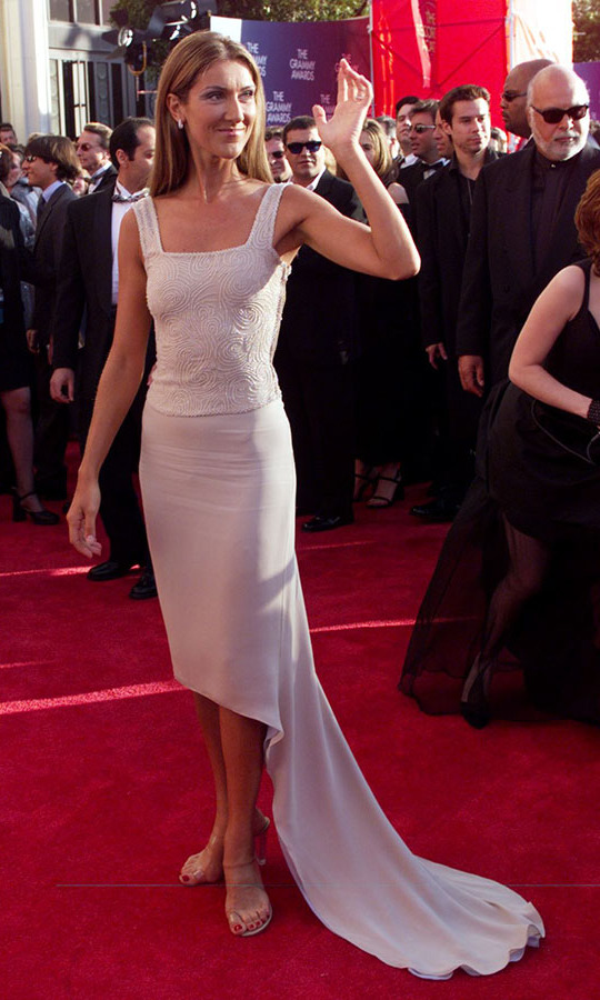 "<h2>Céline Dion, 1999</h2><p><a href=/tags/0/celine-dion><strong>Céline Dion</strong></a> looked so elegant in a blush look at the 1999 GRAMMYs. <em>Titanic</em> fans will know it was the year the Canadian songstress won for the Best Female Pop Vocal Award for ""My Heart Will Go On."" <p>Photo: &copy;  Vince Bucci/AFP via Getty Images"