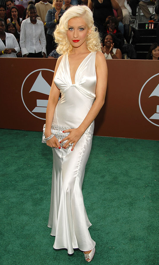 <h2>Christina Aguilera, 2006</h2><p><a href=/tags/0/christina-aguilera><strong>Christina Aguilera</strong></a> channeled <strong>Marilyn Monroe</strong> at the 2006 GRAMMYs with her silky white gown, blonde curls and red lipstick. <p>Photo: &copy; Kevin Mazur/WireImage for The Recording Academy