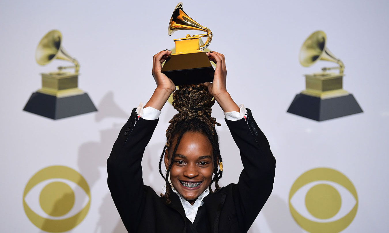 "Jamaican singer <strong>Koffee</strong> happily posed with the award for Best Reggae Album for ""Rapture."" <p>Photo: &copy; FREDERIC J. BROWN/AFP via Getty Images"