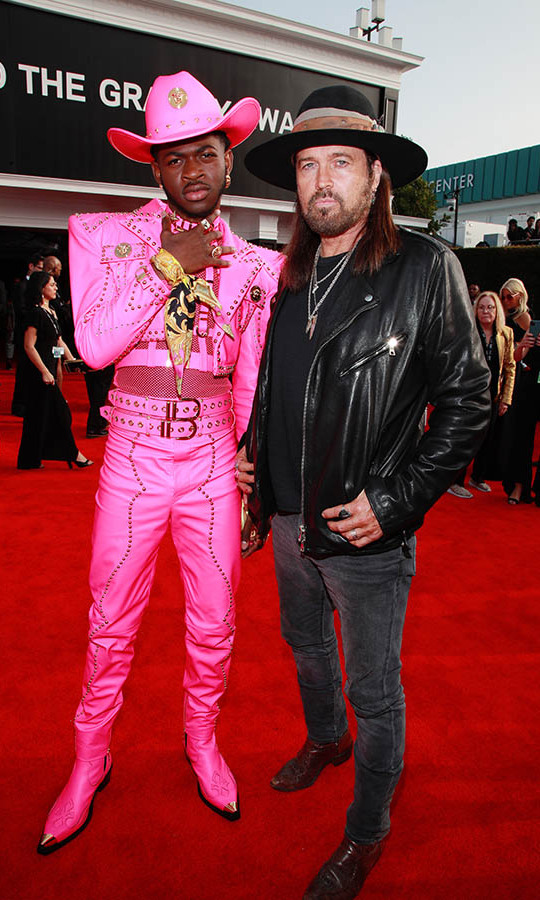 There was no missing <strong>Lil Nas X</strong> is an electric pink <a href=/tags/0/versace><strong>Versace</strong></a> suit. He posed with <strong>Billy Ray Cyrus</strong> on the Grammys red carpet. <p>Photo: &copy; Rich Fury/Getty Images for The Recording Academy