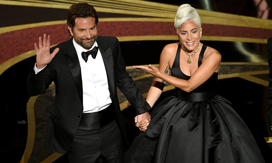 "<strong><a href=/tags/0/lady-gaga>Lady Gaga</a></strong> and <strong><a href=/tags/0/bradley-cooper>Bradley Cooper</a></strong> (pictured at the 2019 Academy Awards) won the Best Song Written for Visual Media award for ""I'll Never Love Again"" from <I>A Star is Born</I>.