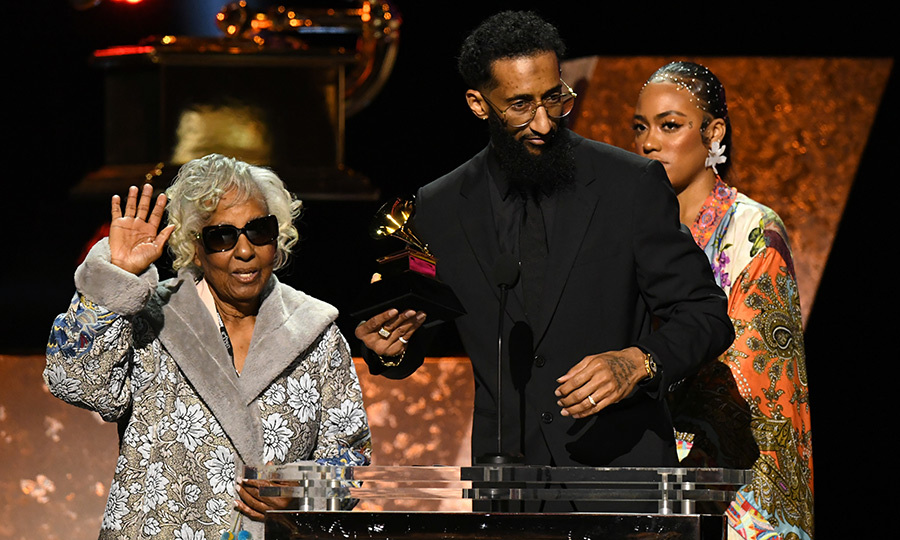 <strong>Nipsey Hussle</strong>'s mother and brother, <strong>Angelique Smith</strong> and <strong>Samuel Asghedom</strong>, accepted the Best Rap Performance award on Nipsey's behalf. Nipsey died at age 33 last year. 