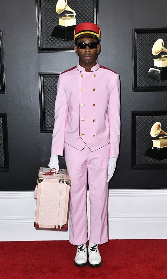 <strong>Tyler, the Creator</strong>'s pale pink suit and accessories were a perfectly themed look!  Note the gloves. <p>Photo: &copy; Frazer Harrison/Getty Images for The Recording Academy