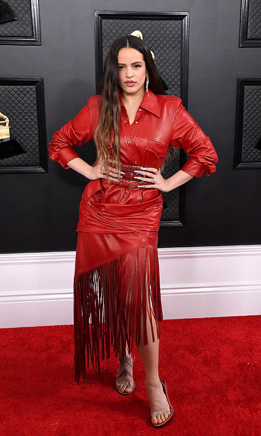 Gorgeous in red! Best New Artist nominee <strong>Rosalía</strong> sizzled in a fringed red ensemble. Her long glittering nails made as much of an impact as her outfit. <p>Photo: &copy; Steve Granitz/WireImage