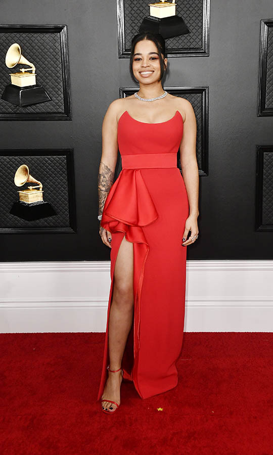 English singer <strong>Ella Mai</strong> looked sensational in a red gown with frill and leg-revealing slit. <p>Photo: &copy; Frazer Harrison/Getty Images for The Recording Academy