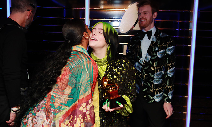 <strong><a href=/tags/0/her>H.E.R.</strong></a> congratulated Billie backstage.
