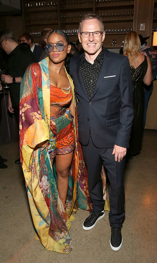 <a href=/tags/0/her><strong>H.E.R.</strong></a> opened up the belted robe dress she wore on the GRAMMYs red carpet to reveal even more playful pattern underneath. Here she is posing with RCA Records CEO & Chairman <strong>Peter Edge</strong> at the Sony Music Entertainment 2020 post-GRAMMY reception. <p>Photo: &copy; Jesse Grant/Getty Images for Sony