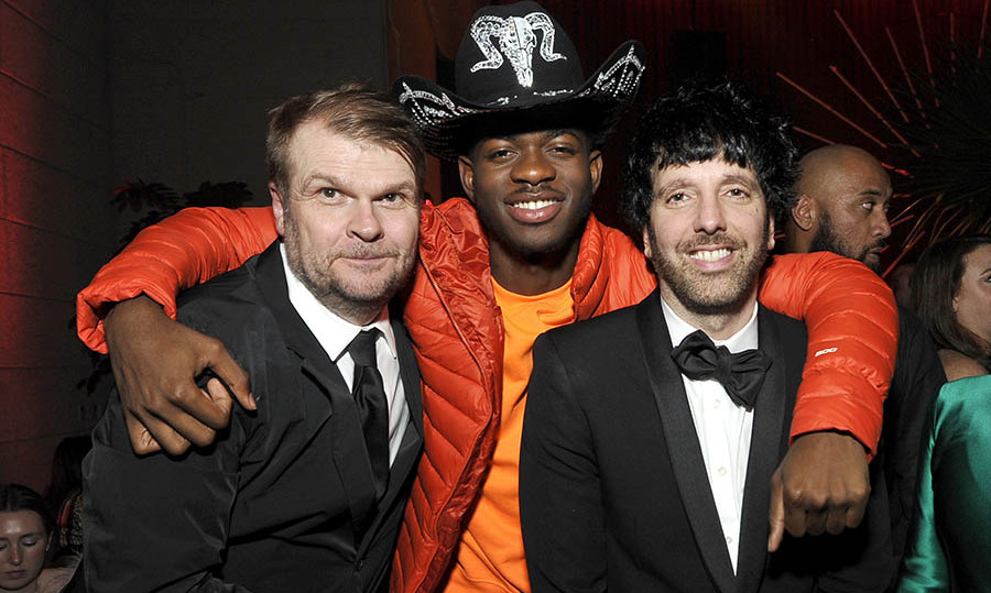 After making a statement in neon pink on the red carpet, <a href=/tags/0/lil-nas-x><strong>Lil Nas X</strong></a> continued to show his love of colour with vivid orange separates. He put his arms around Sony Music Group Chairman <strong>Rob Stringer</strong> and Columbia Chairman & CEO <strong>Ron Perry</strong> at the Sony Music Entertainment 2020 post-GRAMMY reception. <p> Photo: &copy; John Sciulli/Getty Images for Sony