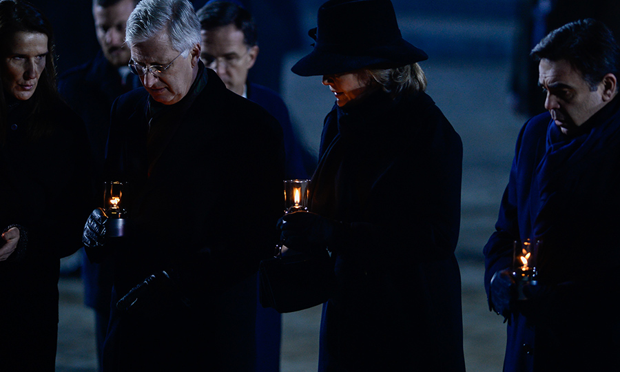 Belgium's King Philippe and Queen Mathilde were among those who lit candles. 