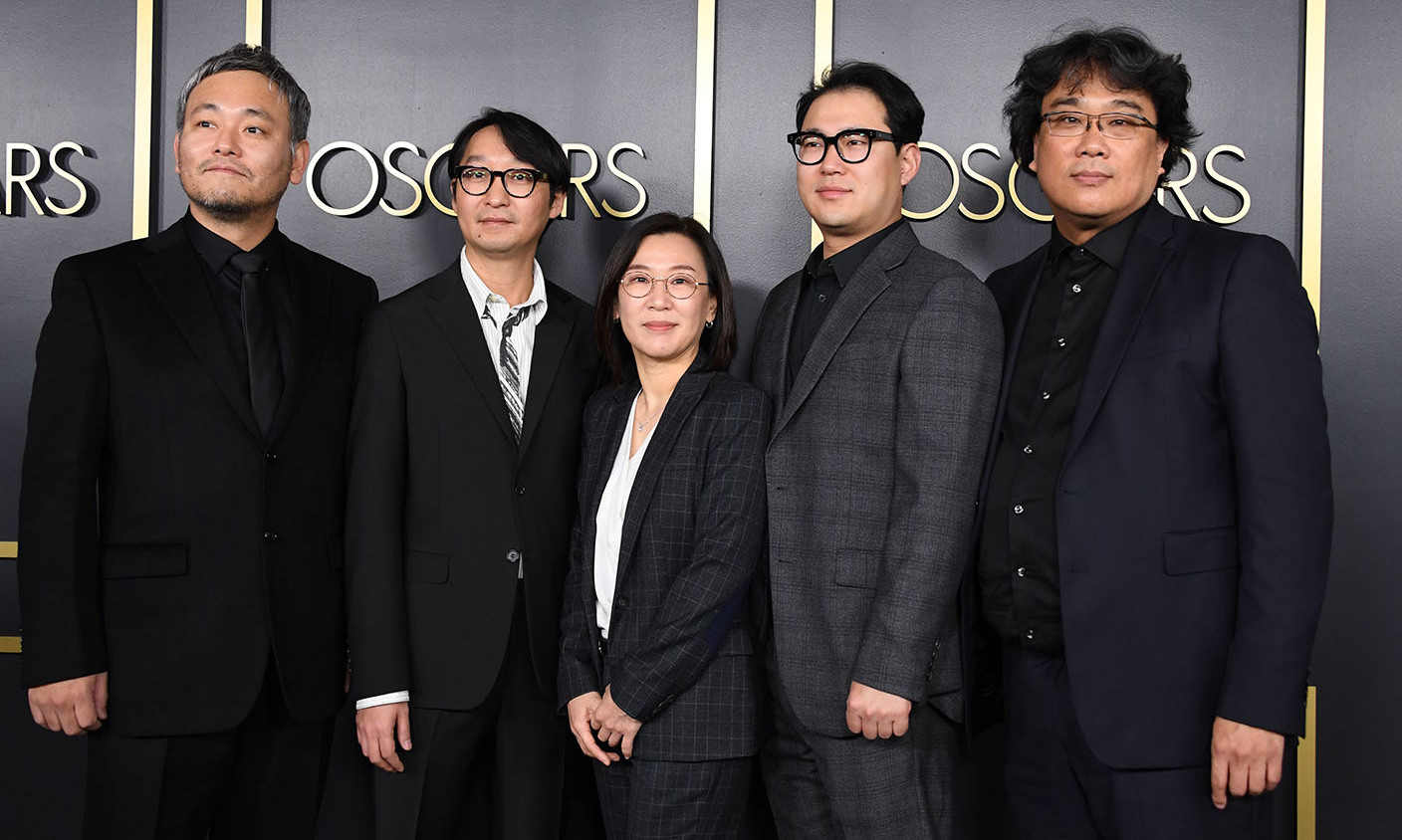 The crew of groundbreaking film <em>Parasite</em>, (L-R) <strong>Ha-jun Lee</strong>, <strong>Yang Jin-mo</strong>, <strong>Sin-ae</strong>, <strong>Han Jin Wan</strong> and director <strong>Bong Joon Ho</strong>, had a coordinated arrival in black suits at the event. The critically acclaimed film is up for six nominations, including Best Picture. <p> Photo: &copy; VALERIE MACON/AFP via Getty Images