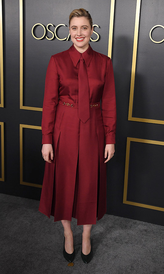 <a href=/tags/0/greta-gerwig><strong>Greta Gerwig</strong></a>, who is nominated for the Academy Award for Best Adapted Screenplay for <em>Little Women</em>, looked beautiful in a <a href=/tags/0/gucci><strong>Gucci</strong></a> garnet red look complete with a tie and pleated skirt.<p>Photo: &copy; Steve Granitz/WireImage