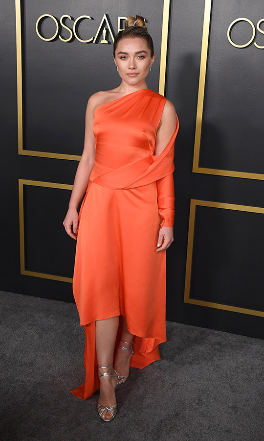First-time nominee <a href=/tags/0/florence-pugh><strong>Florence Pugh</strong></a> had all eyes on her thanks to this vivid orange <strong>Monse</strong> dress with asymmetrical detailing. <p>Photo: &copy; Steve Granitz/WireImage