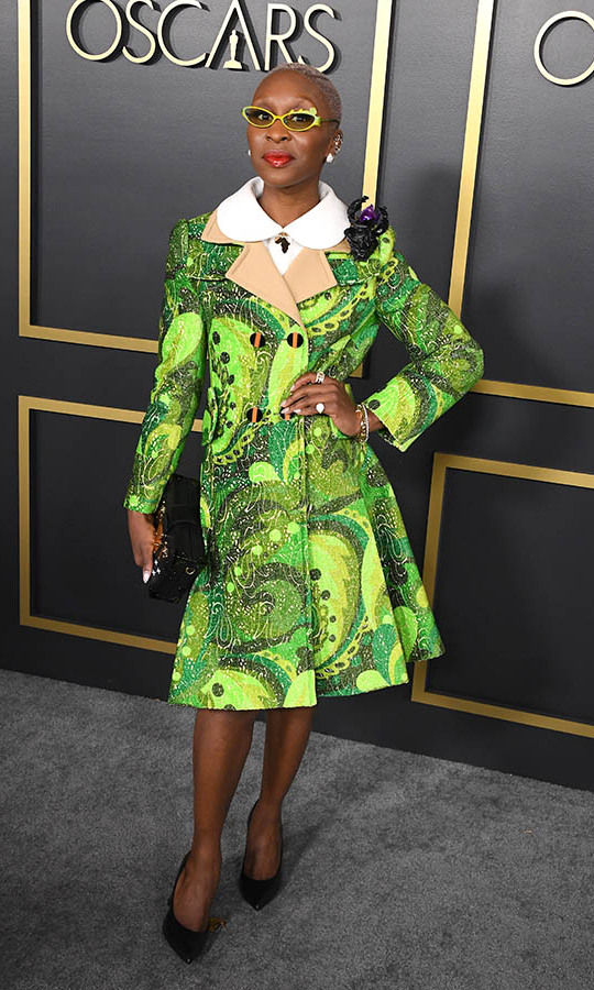 Double nominee <a href=/tags/0/cynthia-erivo><strong>Cynthia Erivo</strong></a> showcased her bold aesthetic in a swirling green coat and coordinating glasses. Based on this electric outfit, we cannot wait to see what the <em>Harriet</em> actress will wear to the 2020 Oscars! <p>Photo: &copy; Steve Granitz/WireImage