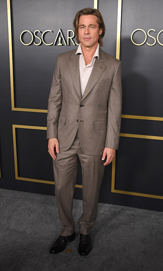 Best Supporting Actor nominee <a href=/tags/0/brad-pitt><strong>Brad Pitt</strong></a> looked suave in a neutral polo shirt and suit on the black carpet of the event. <p>Photo: &copy; Steve Granitz/WireImage